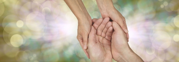 Holding hands in gesture of kindness