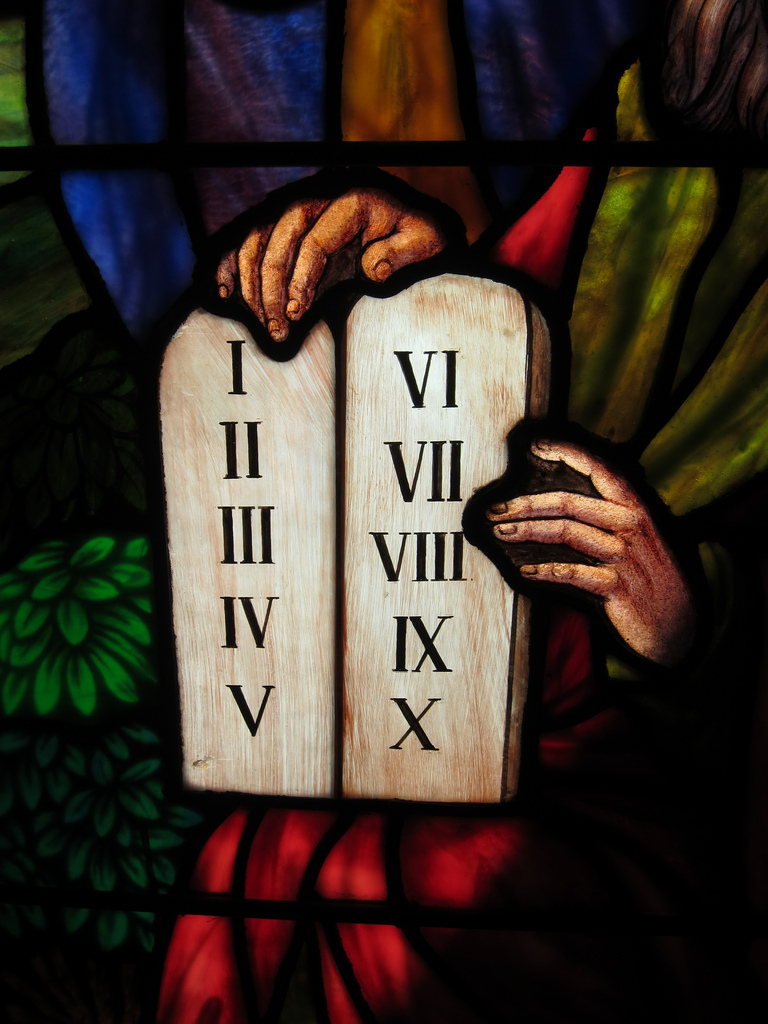 Ten commandments tablet on stained glass