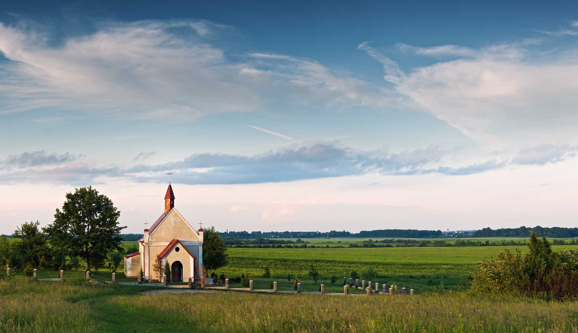 Catholic church on green meadow