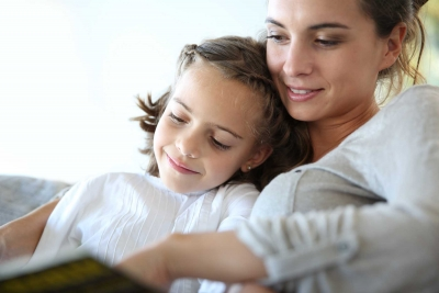 Mom with little girl reading